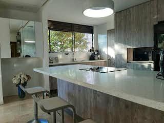 Un cuarto de baño con lavabo y un espejo en FOR SALE APARTMENT / LALINDE EL POBLADO MEDELLIN