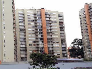 Un gran edificio con un montón de flores en él en Apartamento En Arriendo/venta En Bogota Colina Campestre