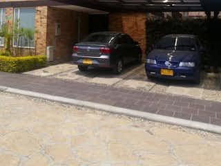 Un coche estacionado delante de un edificio en Casa en venta en El Lucero de 222m² con Jardín...