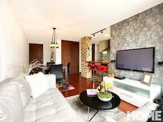 Una sala de estar llena de muebles y una televisión de pantalla plana en APTO REMODELADO CON GRANDES ESPACIOS – VENTA – Cra 21 Cll 108 – CHICO NAVARRA