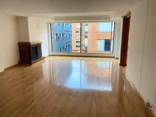 Una sala de estar llena de muebles y una ventana en VENDO:APARTAMENTO;NOGAL:125M2:2H:2G