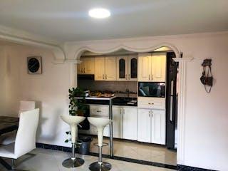 Una cocina con una estufa de nevera y fregadero en Apartamento en Venta Los Colores Medellín