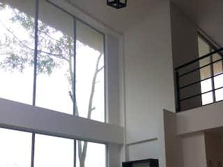 Una vista de una sala de estar desde una ventana en ¡Hermosa casa para estrenar! Conjunto en Cerca de Piedra Chia