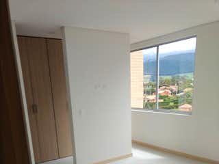Una vista de la cocina desde el camino de la puerta en Acogedor apartamento en venta Cajicá