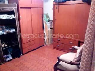 Un cuarto de baño con un inodoro y un lavabo en Apartamento en venta en Casco Urbano Tocancipá de 5 habitaciones