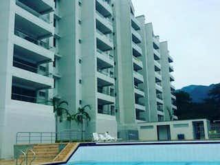 Un gran edificio con un reloj en el lado en Apartamento en venta en Casco Urbano San Jerónimo de 75m² con Gimnasio...