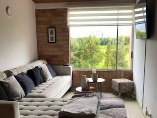 Una sala de estar llena de muebles y una ventana en Apartamento en venta en San Antonio Norte, de 52mtrs2
