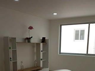 Una sala de estar llena de muebles y una ventana en Iluminado departamento en Venta!!