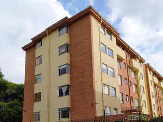 Un edificio de ladrillo alto con un techo rojo en 104331 - Espectacular Apartamento en Ciudad Jardín Norte