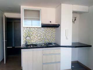 Una cocina con nevera y fregadero en Vendo apartaestudio Galerias Lindisimo