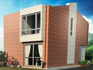 Un edificio de ladrillo con un gran ventanal con un gato en él en Casa En Venta En Chia Vereda Fagua