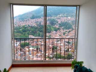 Una vista de una sala de estar desde una ventana en APARTAMENTO EN BUENOS AIRES  PARTE ALTA PARA LA VENTA
