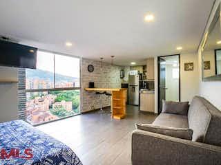 Una sala de estar llena de muebles y una gran ventana en La Frontera PH