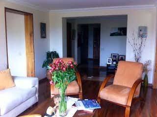 Una sala de estar llena de muebles y una planta en maceta en Conjunto Salamanca
