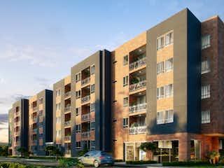 Un edificio alto sentado al lado de un edificio alto en Precio, Apartamento en venta en Parque/Centro 57m² con Gimnasio...