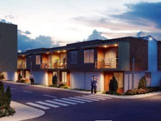 Una calle de la ciudad con un edificio en el fondo en Confort, elegancia y tranquilidad. Palabras que describen el proyecto