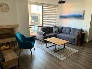 Una sala de estar llena de muebles y una mesa de café en ESPECTACULAR APARTAMENTO EN VENTA EN BELLA SUIZA