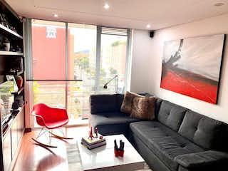 Una sala de estar llena de muebles y una ventana en VENTA HERMOSO APARTAMENTO CONTADOR