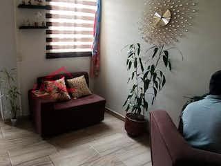 Una sala de estar llena de muebles y una chimenea en Santa María del Buen Aire