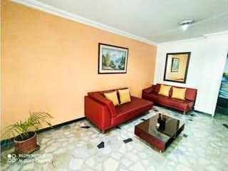 Una sala de estar llena de muebles y una ventana en Apartamento en venta en Barrio Venecia de 60m²