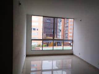 Una vista de una sala de estar con una ventana en Apartamento en venta en La Felicidad de tres habitaciones