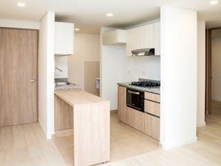Una cocina con una estufa y un refrigerador en Apartamento Balzani - Fontibón