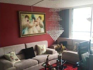 Una sala de estar llena de muebles y una pintura en Apartamento Imperial Reservado I - Suba