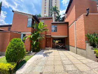 Un edificio de ladrillo con una planta en maceta en Venta Casa en Loma de los Bernal Medellin