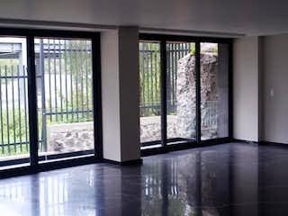 Una vista de una sala de estar desde una ventana en Departamento venta renta San Jeronimo