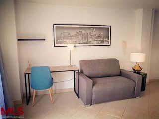 Un sofá y una silla en una habitación en Maria de la Paz