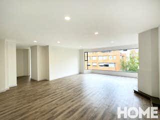 Una vista de una sala de estar y una sala de estar en APTO SEMI REMODELADO CON GRAN AREA SOCIAL – VENTA – Cll 95 Cra 16 – CHICO