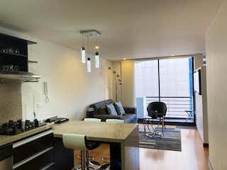 Una cocina con un fregadero, una estufa y una ventana en Apartamento En Venta En Bogota Santa Barbara