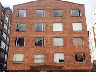 Un gran edificio de ladrillo con un edificio de ladrillo rojo en Apartamento En Venta En Bogota Victoria Norte