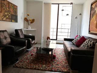 Una sala de estar llena de muebles y una chimenea en BOGOTA, VENTA APARTAMENTO EN SANTA BARBARA, 71 MTS