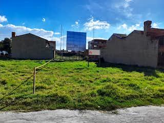 Una vista de un edificio con una torre de reloj en el fondo en Excelente, Lote en venta en Casco Urbano Chía de 352m²
