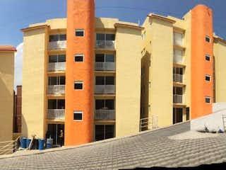 Una imagen de un edificio con una torre de reloj en Departamento en Venta en Lomas Lindas 2da Secc Atizapán de Zaragoza