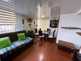 Una sala de estar llena de muebles y una ventana en VENTA DE INMUEBLE MODELIA ( FONTIBON )