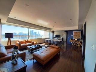Una sala de estar llena de muebles y una televisión de pantalla plana en Departamento en venta en El Yaqui de 2 recámaras