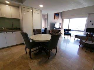 Una sala de estar llena de muebles y una mesa en Departamento en venta en El Yaqui de 2 recámaras