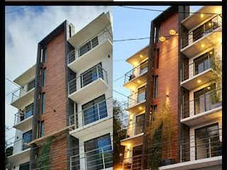 Un edificio alto sentado en la esquina de una calle en Departamento en venta en Santa úrsula Coapa 68m²