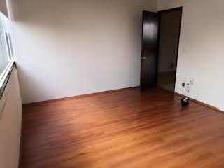Una puerta de madera en una habitación con suelo de madera en Departamento en Venta enFracc Lomas Country Club, de 254mtrs2