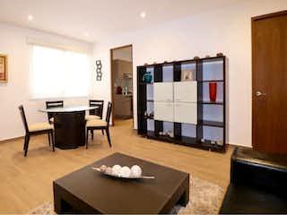 Una sala de estar llena de muebles y una televisión de pantalla plana en Departamento en Venta en Santa Lucia Reacomodo Álvaro Obregón