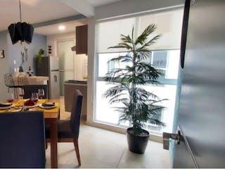 Una sala de estar llena de muebles y una planta en maceta en Departamento en venta en Bondojito con acceso a Jardín