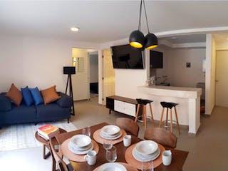 Una sala de estar llena de muebles y una mesa en Departamento en venta en Guadalupe Victoria, 58m²