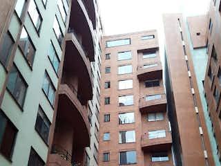 Un edificio alto con muchas ventanas en Apartamento en Venta TEUSAQUILLO