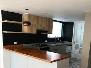 Una cocina con un fregadero y un horno de cocina en VENTA APARTAMENTO SANTA BARBARA AP-222