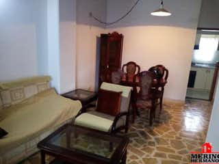 Una sala de estar llena de muebles y un sofá en EDIFICIO LA MANUELA 2