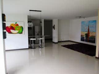 Una cocina con nevera y fregadero en Apartamento en venta en Los Gonzales de tres habitaciones