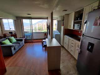 Cocina con nevera y horno de fogones en Apartamento en venta en Loma del Indio de una habitaciones