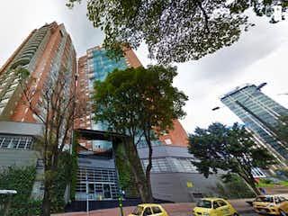 Un edificio con una torre de reloj en el centro en Apartamento en Venta CENTRO INTERNACIONAL